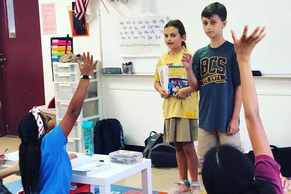 students teach students in fifth grade
