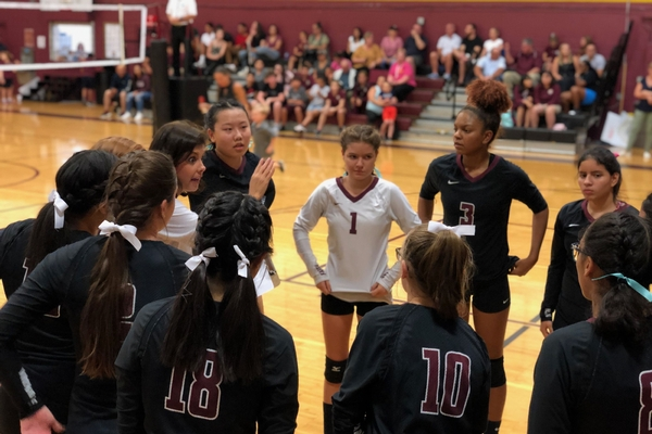 bcs varsity volleyball players get directions from coach humenansky